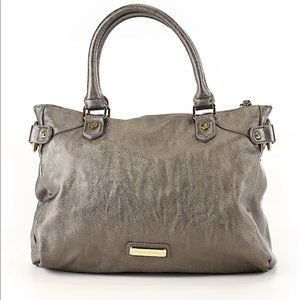 Steve Madden gray hand bag with gold hardware.